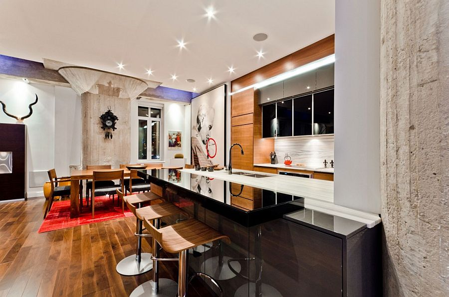 Blend of contrasting textures and bright red hues enliven the contemporary loft