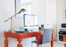 Bright orange desk brings color to the home office