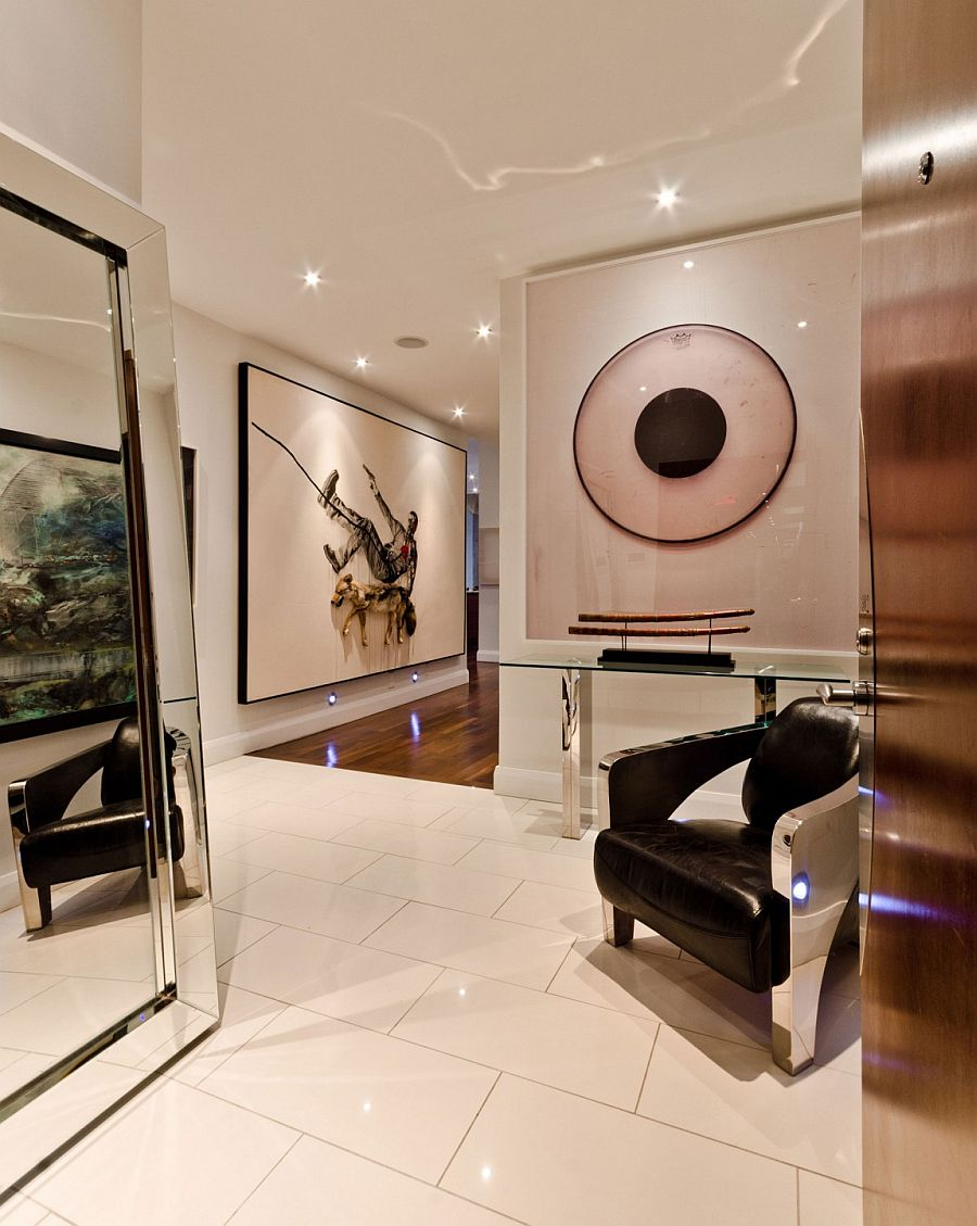 Brilliant art collection of the homeowner stands out visually in the hallway