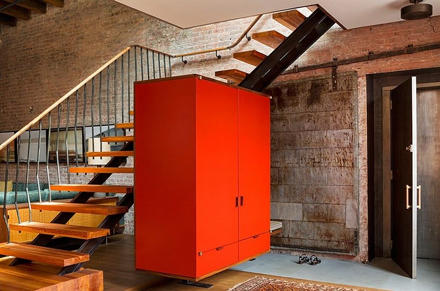 Brilliant orange cabinet becomes the statement piece in the living area