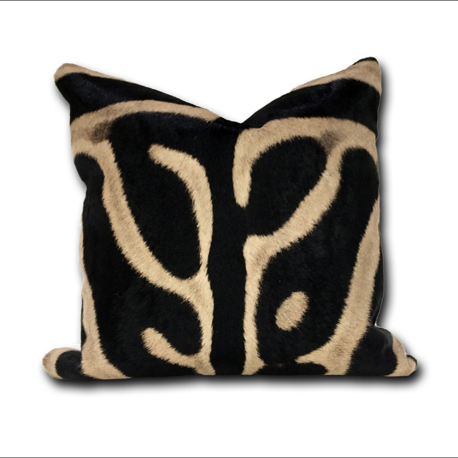 Bring natural beauty to your living room with a cowhide pillow