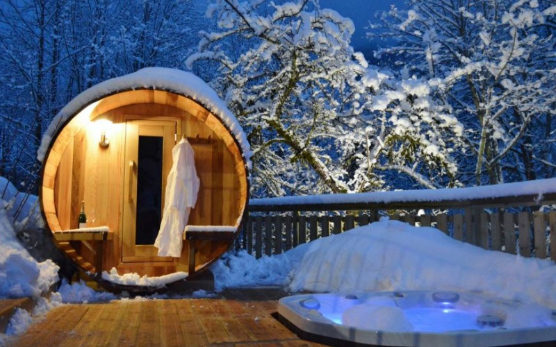 Chalet Twenty26 in the French Alps boasts both a sauna and a hot tub (foreground)