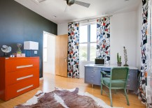 Chalkboard paint wall in the home office becomes the perfect backdrop for the bold orange cabinet