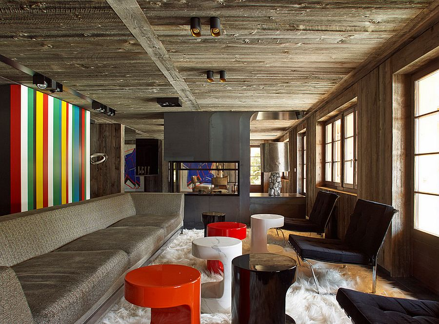 Colorful accent wall brings contemporary appeal to a rustic living room [Design: Thierry Lemaire interior & design]
