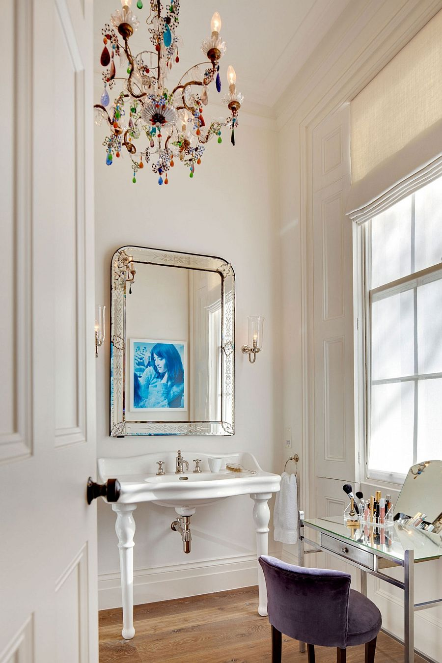 Colorful chandelier in the powder room steals the show