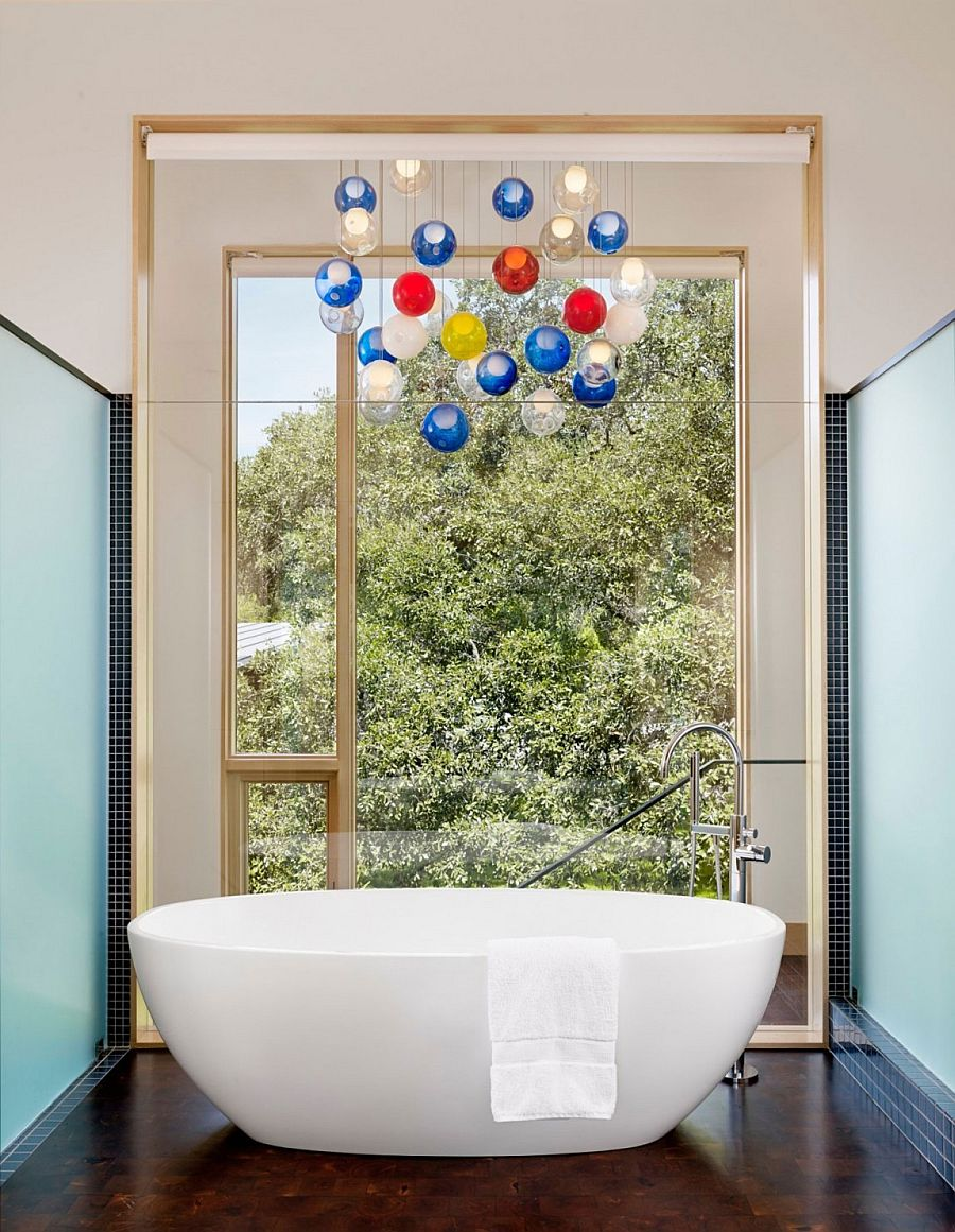 Colorful lighting fixture enlivens the contemporary bathroom