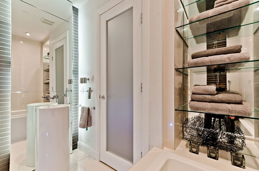 Contemporary bathroom with glass shelves for towel storage