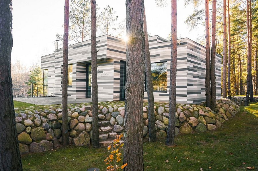 Contemporary exterior with gray tones mimics the hues of a birch stump Forest House Gets Stunning Exterior with Different Shades of Grey Tiles