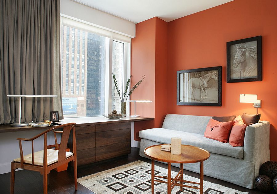 Contemporary home office in New York with orange and subtle hints of black and gray [Design: Stedila Design]