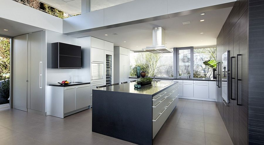 Contemporary kitchen in black and white with garden views