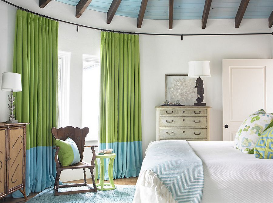 Curtains bring color and elegance to the beach style bedroom [Design: Carter Kay Interiors]
