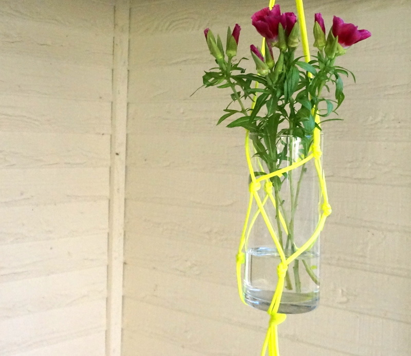 DIY hanging vase with purple flowers