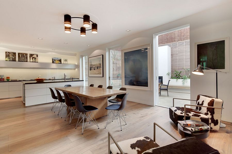Dining area and kitchen that is connected visually with the spaces outside