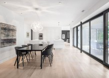Dining table and chairs in black bring visual contrast to the home