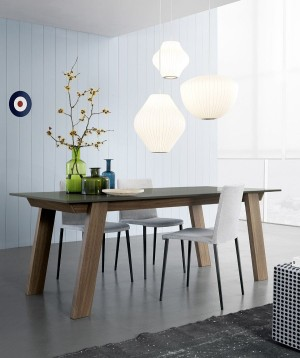 Elegant Victor table combines warmth of wood with contemporary design