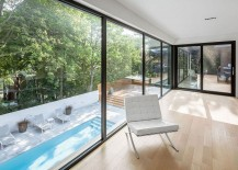 Elegant view of the landscaped terrace and pool from the extension