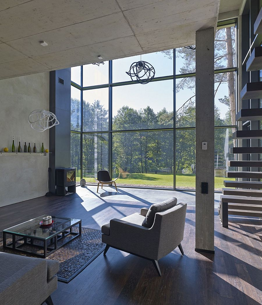 Exposed concrete and glass shape the spacious living area with minimal overtones