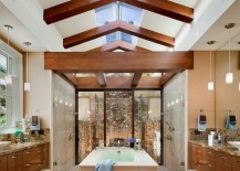 Exquisite bathroom with two showers 217x155 23 Gorgeous Bathrooms That Unleash the Radiance of Skylights