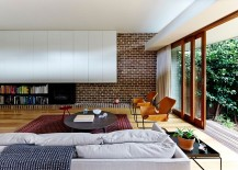 Exquisite use of brick wall and contrasting texures in the lovely living space