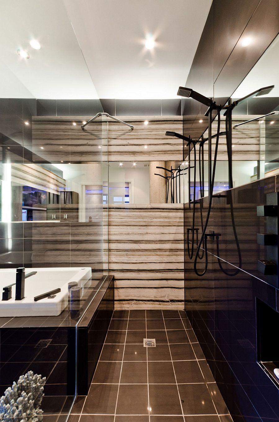 Exquisite use of glass gives the small bathroom a spacious appeal