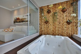 Fabulous bamboo wall acts as the perfect backdrop for a tranquil, soothing dip