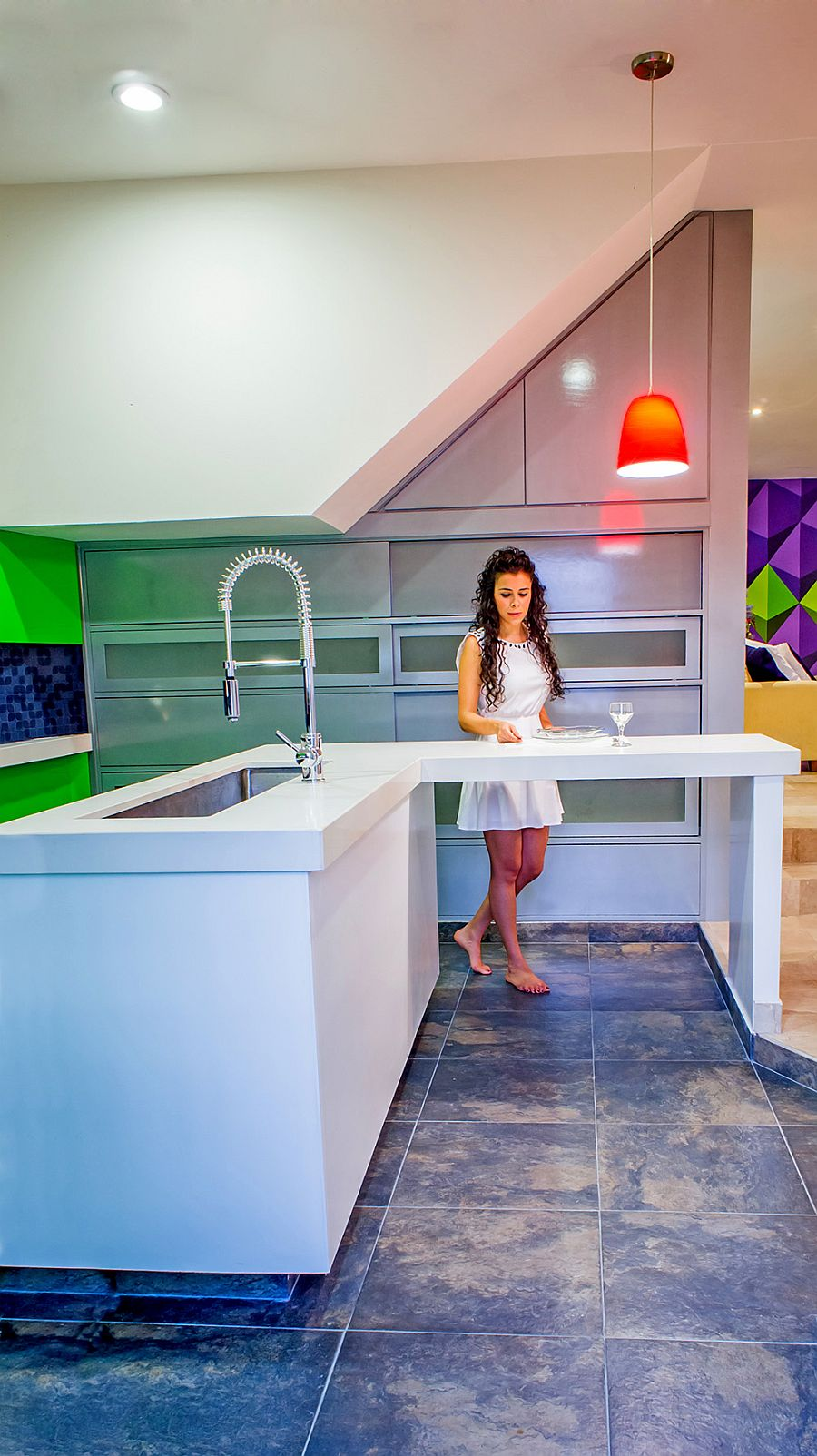 Fabulous contemporary kitchen in white with a colorful backdrop
