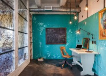 Fabulous industrial style home office with as splash of blue