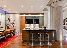 Fabulous modern kitchen with wooden accents and ingenious wall art
