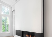 Fabulous, sleek fireplace adds to the appeal of the contemporary addition