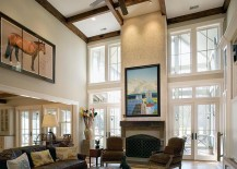 Fireplace, ceiling beams and wall art combine to give the living room a stunning ambiance