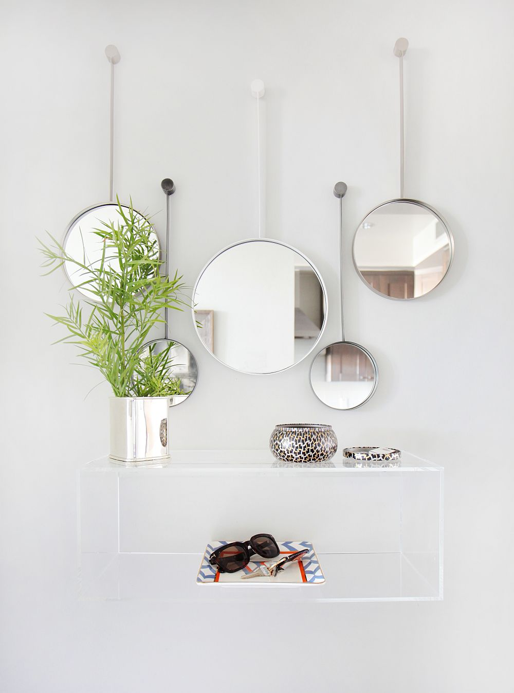 Floating acrylic vanity and mirrors in the modern home