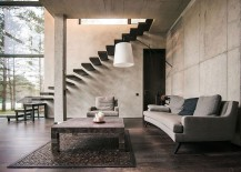 Floating staircase leading to the top level of the house