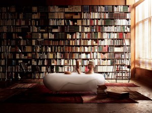 Foam spa in the bathroom along with an imposing shelf full of books