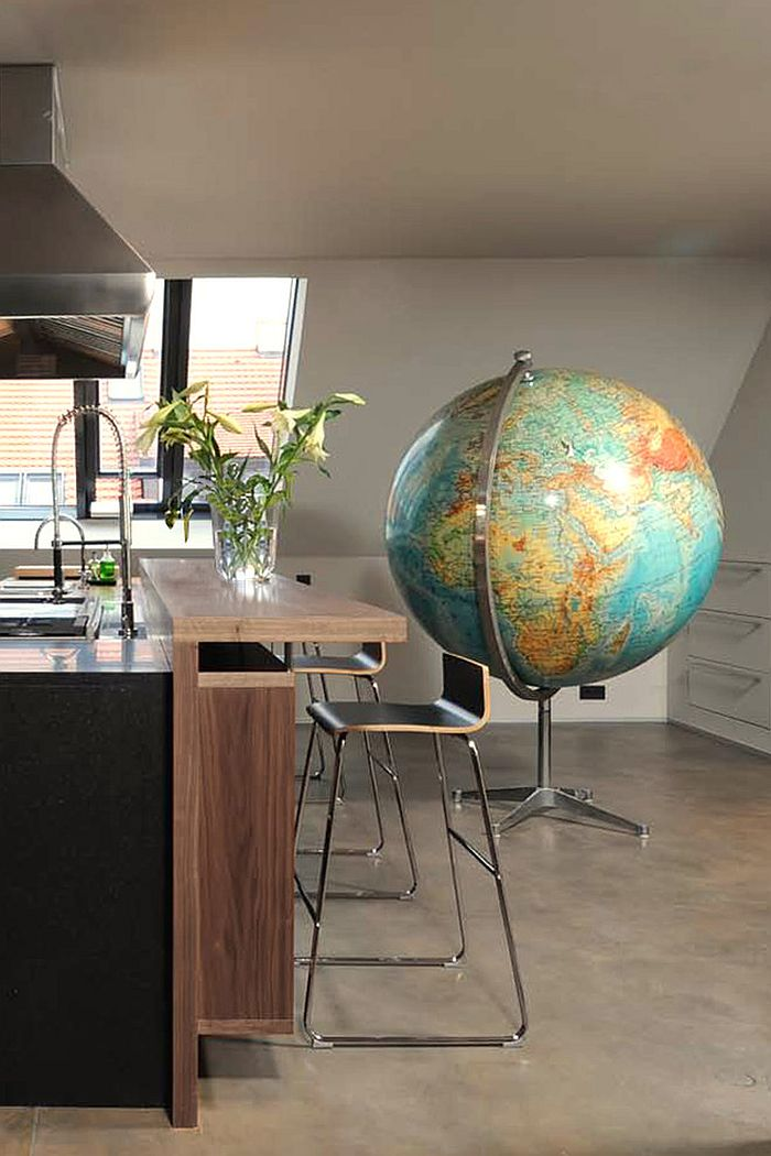 Giant globe in the kitchen stands out as an ingenious addition!