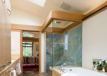 Give the narrow, modern bathroom an airy appeal with the skylight