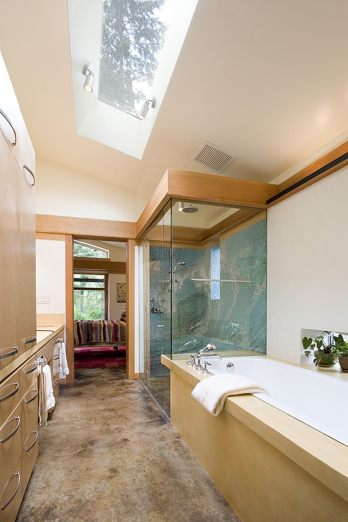 Give the narrow, modern bathroom an airy appeal with the skylight [Design: Balance Associates Architects]
