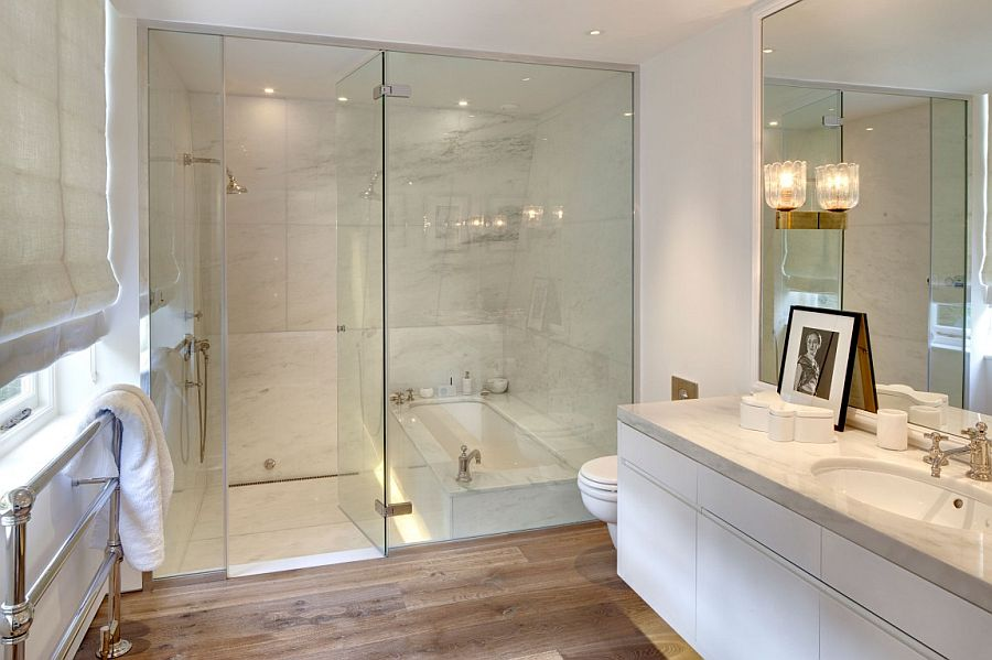 Glass shower enclosure in the traditional white bathroom