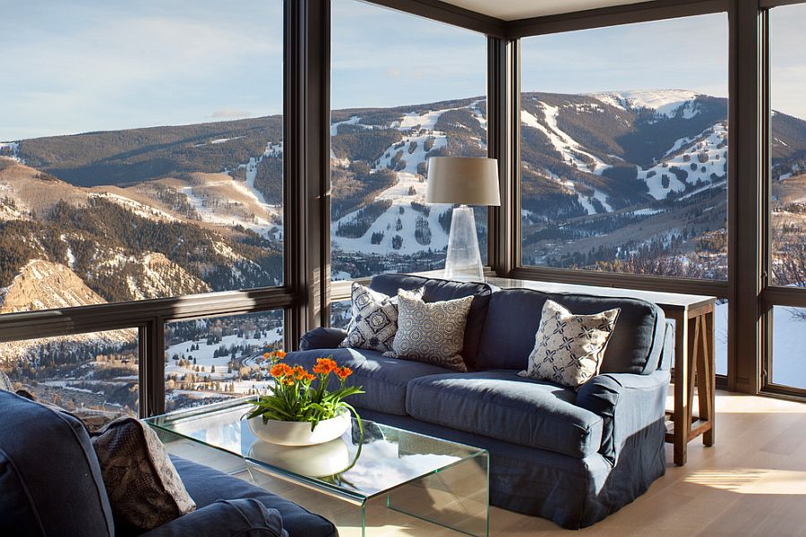 Glass walls open up the living room to the view outside