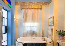 Gold brings an air of regality to the bathroom
