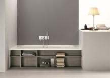 Gorgeous modern bathtub with built-in bookshelves