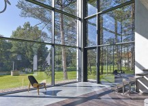 Grand use of glass windows brings the forest indoors visually