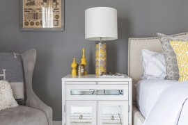 Gray bedroom with simple yellow accents
