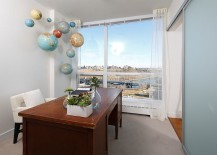 Hanging globes in the home office make a quirky addition