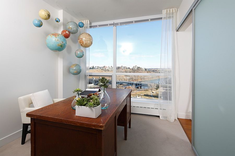 Hanging globes in the home office make a quirky addition [Design: i3 design group]