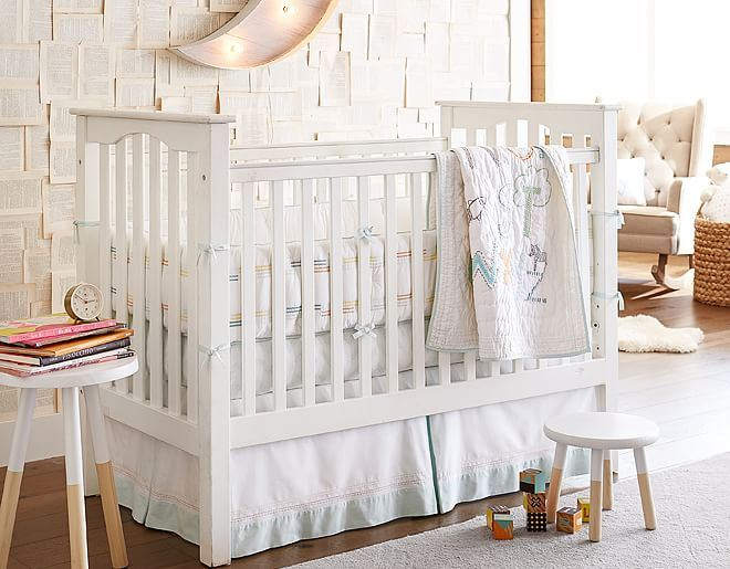 Hardwood flooring and a rug in a beautifully designed nursery