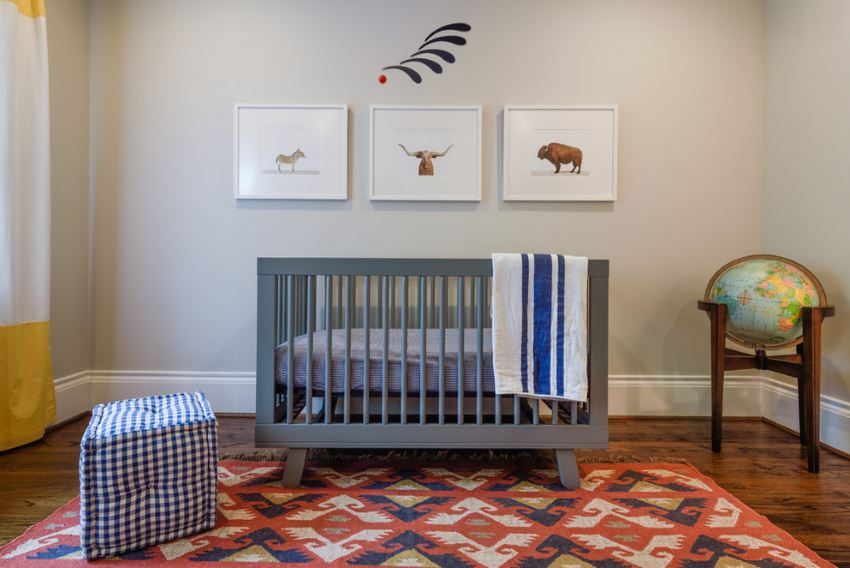 Hardwood flooring and an area rug in a modern nursery