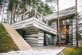 Forest House Gets Stunning Exterior with Different Shades of Grey Tiles