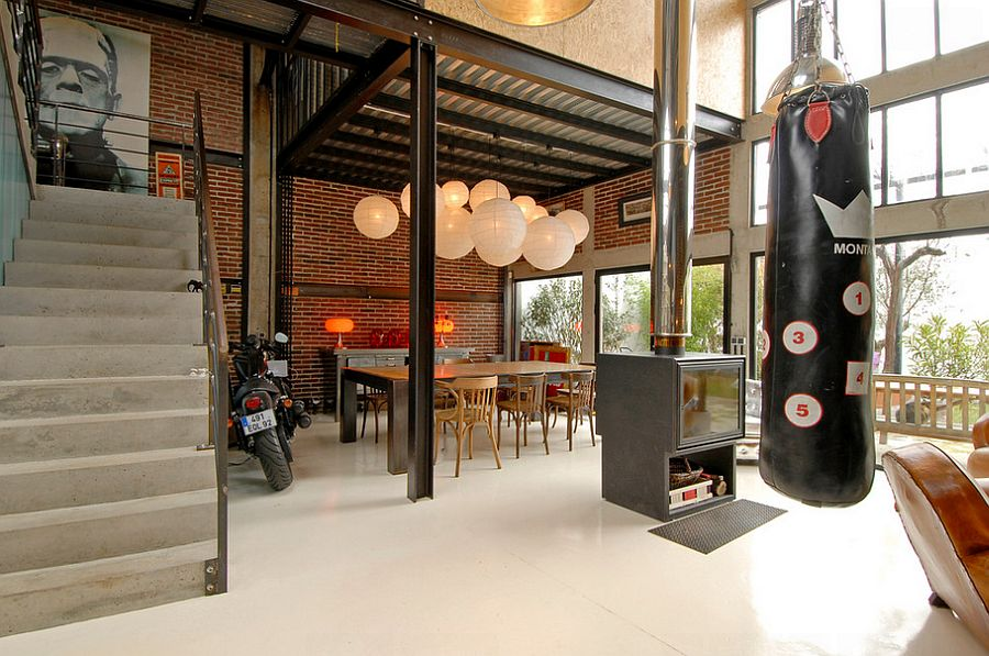 Industrial loft with a dashing dining room and decor! [Design: Zoevox]