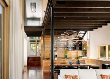 Ingenious-lighting-fixture-and-the-ceiling-beams-give-the-interior-a-unique-ambiance-217x155
