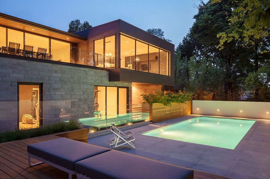 Intriguing pool and sunken deck design adds to the appeal of the Canadian home